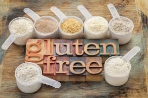 measuring scoops of gluten free flours (almond, coconut, teff, f